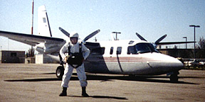 me in round parachute gear at Paso Robles airport, CA